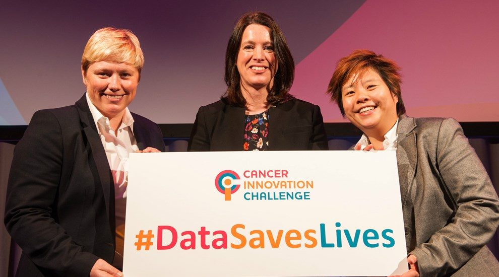 Photo of 3 women holding Cancer Innovation Challenge sign #DataSavesLives