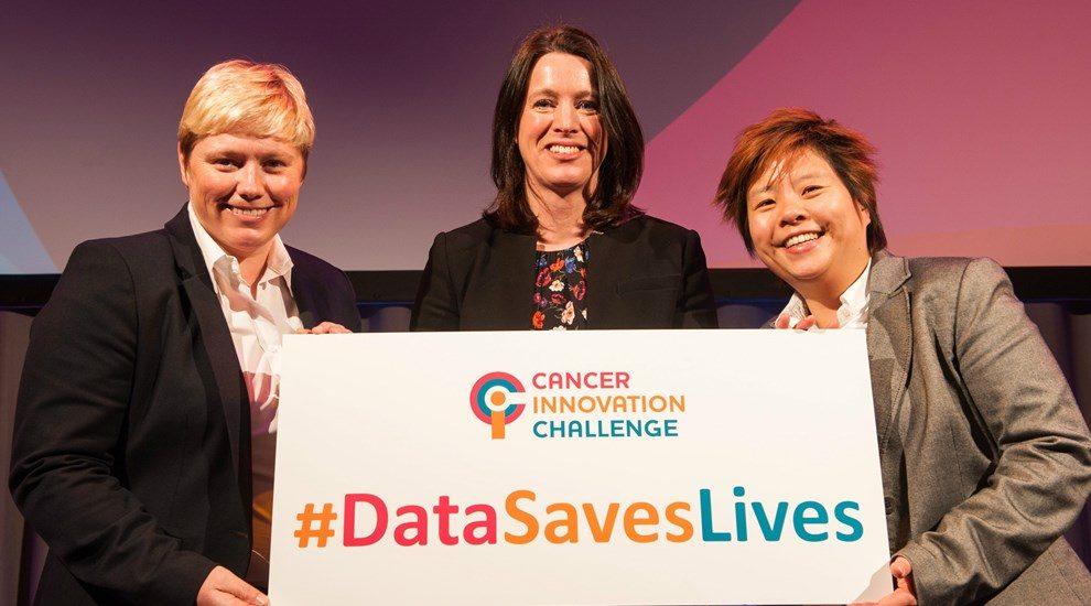 Photo of 3 women holding Cancer Innovation Challenge sign #DataSavesLives
